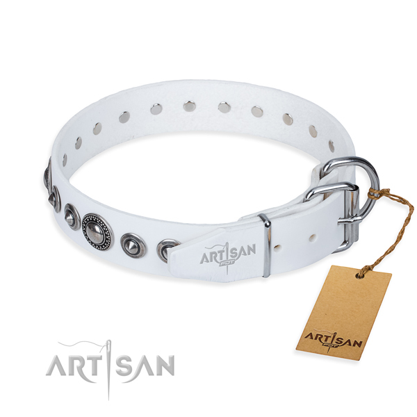 Full grain leather dog collar made of gentle to touch material with corrosion resistant adornments