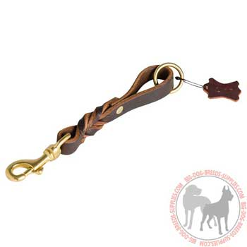 Leather dog leash pull tab for managing large canines